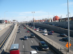 The Dcarie Expressway (Highway 15) in Montreal. (Steve Brandon) Tags: urban canada cars geotagged restaurant vanishingpoint highway traffic montral quebec montreal fastfood overpass mcdonalds gasstation qubec autos circulation  automobiles petrocanada voitures servicestation tmr franchise urbanblight eyesore   orangejulep highway15  decarie  serviceroad gibeauorangejulep  townofmountroyal  autoroute15 autoroutedcarie dcarieexpressway decarieboulevard boulevarddcarie  dcarieboulevard  rubyfooshotel lhtelrubyfoos ruepar parstreet ferrierstreet dcarieautoroute rueferrier