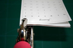 Punching the holes through the calendar's pages and stand