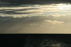 Black Ocean (Audiotribe) Tags: ocean blue light sky orange sun black color colour sol nature water yellow clouds canon dark denmark skies glow shine natur gray fluffy himmel orangesky lys danmark skyer vand bl aften gr kattegat sams littlefluffyclouds glimse eos400d colorrange colorphotoaward gld skyascanvas