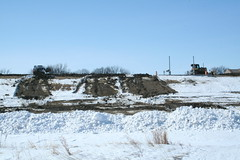 Topping the Dike (GreenLight Designs (Jordan Green)) Tags: snow canon flood northdakota redriver eos350d dike lincolnpark heavymachinery levee grandforks efs1855 redriverofthenorth eosxt floodprotection floodfight gowanconstruction
