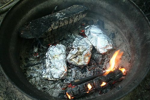 Campfire Pizzas Cooking in Coals