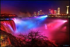 Niagara Falls New York [EXPLORE] (Moniza*) Tags: longexposure light ny newyork reflection water night niagarafalls waterfall illumination niagara explore nightlight lightshow americanfalls lightstream niagarafallscanada niagarafallsusa explored moniza
