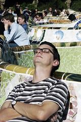 Park of dreams © Rob Watkins 2003 (Aland Rob) Tags: barcelona park old sleeping people sun man tile relax glasses spain barca sitting arms sleep tourist catalonia sit siesta catalunya sat asleep mosiac seated guell antoni catalan crossed cataluna gell gaud photograph©robwatkins