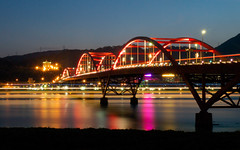Guandu Bridge  (olvwu | ) Tags: longexposure bridge light red sky mountain reflection building night river flickr arch riverside dusk taiwan mangrove taipei 888 guandu 1260 jungpangwu oliverwu oliverjpwu flickrexplore explored danshueiriver olvwu guandubridge kuanyinshan 080808 20080808 jungpang  flickr888