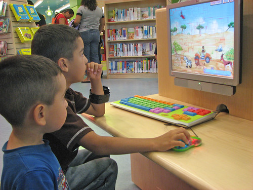 Children use a library computer