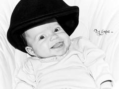 titi parisien 2 (s'ansas) Tags: girls portrait blackandwhite smile look hat eyes nikon babies noiretblanc oeil yeux chapeau childs onwhite enfant fille sourire bb blackdiamond regard bret blackwhitephotos fondblanc portraitworld sansas memorycornerportraits