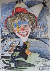 JyBy in clown playing the piano