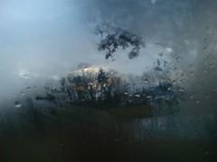 through the window (Norotschka) Tags: wasser sonnenuntergang fenster grau blau fluss trist tropfen verwischt scheibe fensterscheibe melancholische