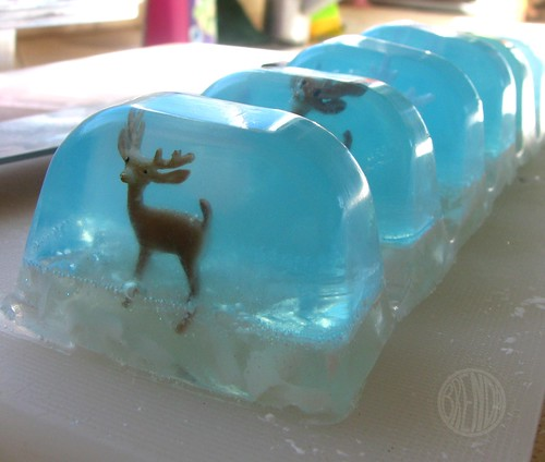 Bars of snow globe soap with reindeer in the middle