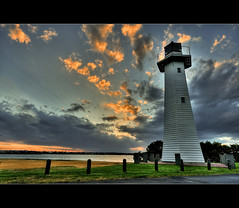 Authority for the light. ([ Kane ]) Tags: blue light sunset sky cloud sun lighthouse house green grass clouds cleveland australia brisbane explore qld rays kane hdr gledhill kanegledhill kanegledhillphotography