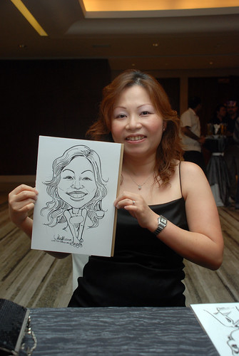 Caricature live sketching for Ezra Holdings 1