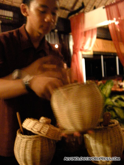 The Rice Master scooping out all the rice variety for us to sample