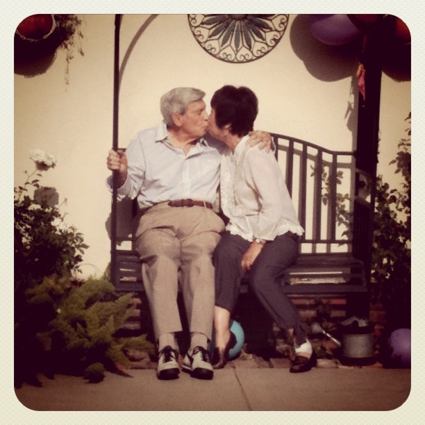 Grandpa & Masumi kissing on his 90th birthday. I just love this shot.