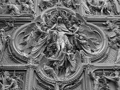 Door Detail, Duomo, Milan (Campbell Mitchell) Tags: door light italy milan detail church la catholic christ cathedral spires milano space gothic carving angels huge mitchell duomo campbell archbishop 1386 tezzamanzi