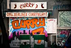 Currywurst (manganite) Tags: pink blue orange signs color berlin wall facade digital buildings cutout kreuzberg germany geotagged graffiti nikon colorful europe tl letters restaurants characters d200 nikkor dslr currywurst 18200mmf3556 utatafeature manganite nikonstunninggallery ipernity date:year=2008 geo:lat=52500082 geo:lon=13443918 date:month=february date:day=24 format:ratio=32