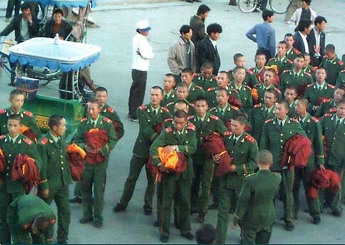 Chinese-soldiers-posing-riot-monks-1