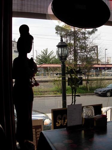 statue in Nadia Thai window-- left side