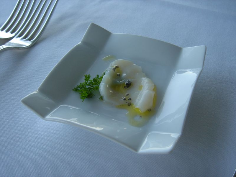 Scallop sashimi with lava salt and lemonade oil