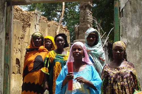 Central African women inspecting building for microfinance project by hdptcar.