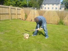 Jan demolishing dolls head (Gilbitron) Tags: doll head spade