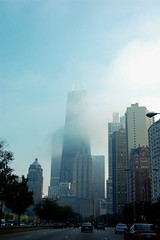 citylife (Mariha.) Tags: road city trees chicago building cars skyline clouds skyscraper lights drive highway driving cityscape traffic sears searstower tall cloudcover manywindows mykindofpicturegallery