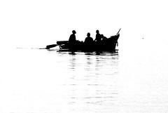 Fishermen's return (photocillin) Tags: africa bw lake boys silhouette wow boat fishing fishermen peaceful malawi serene highkey blackdiamond monart damniwishidtakenthat blackdiamondpremier photocillin gettyvacation2010