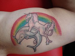 Unicorn and dolphin tattoo