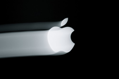 Apple logo streaked in light