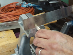 We put the nut blank in a vise and used a saw to start each groove.