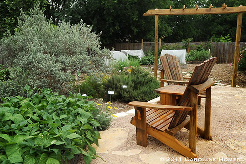 Seating near backyard vegetable garden