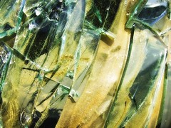 Broken Glass Glowing.12 (mcreedonmcvean) Tags: macro green broken wichitafalls junkyard tone brokenwindshield macrodetails miserautosalvage