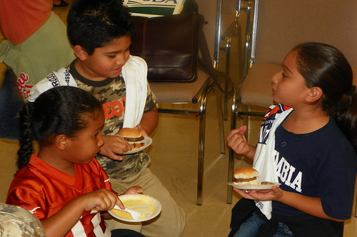 Local San Juan area children sample the nutritious meals that will be distributed to more than 1,500 children at feeding sites this summer.