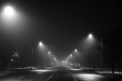 More Mist (Mario.Q) Tags: road street blackandwhite bw mist fog night photography lights streetlights michigan empty lansing handheld canonrebelxt visibility imagestabilization canon1755mmf28isusm