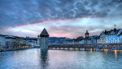 sunset over Chapel Bridge Lucerne (Toni_V) Tags: sunset sky clouds reflections schweiz switzerland europe tripod watertower luzern 2008 lucerne hd
