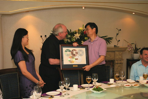 Dean Blocker presents a framed assortment of Yale CDs to President Wang. On the left is Lily Tao, Wangs assistant, who was extraordinarily helpful with many aspects of the tour.