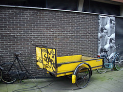 sumo bakfiets (keeshu) Tags: netherlands amsterdam yellow ongrey geel noordholland bakfiets yellowbike yellowbicycle yellowbicycles gelefiets