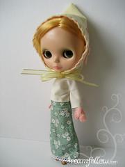 Chloe models hood mittens