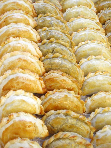 Rows and rows of homemade beef curry pies