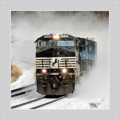 Dashing Through the Snow (Images by A.J.) Tags: railroad winter snow train truck square piggy pig back pennsylvania snowy ns norfolk rail railway trains southern pa transportation greensburg locomotive trailer ge piggyback trailers locomotives generalelectric  intermodal  bsquare   dash9 westmorelandcounty c409w cw409w