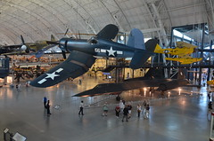 Steven F. Udvar-Hazy Center: Vought F4U-1D Corsair, with P-40 Warhawk and SR-71 Blackbird in background (Chris Devers) Tags: plane airplane virginia smithsonian dulles unitedstates aircraft massachusetts jet va somerville corsair airforce fairfax lockheed usaf blackbird nationalairandspacemuseum sr71 coldwar dullesairport chantilly airandspacemuseum sr71blackbird spyplane supersonic udvarhazy smithsonianinstitution p40 stevenfudvarhazycenter kellyjohnson reconnaissance sr71a speedrecord stevenfudvarhazy f4ucorsair eyefi p40warhawk clarencejohnson curtissp40warhawk voughtf4ucorsair exif:exposure_bias=0ev exif:exposure=0025sec140 exif:iso_speed=800 exif:focal_length=18mm exif:aperture=f35 camera:make=nikoncorporation exif:flash=offdidnotfire camera:model=nikond7000 flickrstats:favorites=1 exif:orientation=horizontalnormal exif:vari_program=autoflashoff exif:lens=18200mmf3556 exif:filename=dsc0068jpg exif:shutter_count=11583 meta:exif=1350331293