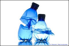 **blue bottles** (treeffe2000) Tags: blue white green backlight studio bottle sb600 used plastic backlit recycle waterdrops squeezed twoobjects enviroment