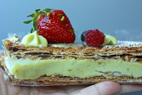 Millefeuille filled with pistachio cream and strawberries