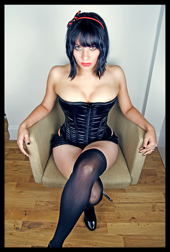 picture of busty lady in opaque Nylons and corset
