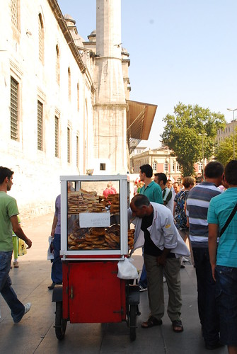Man selling turkish pretzel - simit