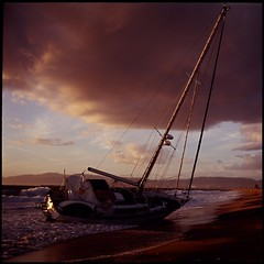 Sailboat Surrender (roostercoupon) Tags: california santa sunset storm 120 6x6 film beach clouds sailboat vintage square bay coast surf purple kodak slide explore shipwreck monica shore plus beached medium format 100 aground russian kiev e6 ran 60 playadelrey