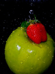 Wet fruit (Leo Druker) Tags: red black green slr apple water fruit 50mm strawberry vivid d300 sb800 nikkor50mm18af