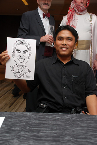 Caricature live sketching for Ezra Holdings 6