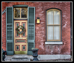 Soulard Neighborhood ~ St Louis Missouri (Bettina Woolbright) Tags: christmas door old city urban holiday color building brick doors decoration stlouis neighborhood christmasdecorations saintlouis bettina woolbright bettinawoolbright woolbr8stl bettinawoolbrightcom