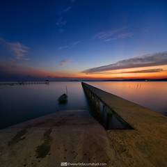 In Between (Firdaus Mahadi) Tags: longexposure light sunset sky sun beach silhouette rock landscape scenery laut malaysia awan fm batu pantai langit portdickson cahaya pemandangan matahari longexposures pasirpanjang petang negerisembilan nd1000 telukkemang vertorama manfrotto055xprob tokina1116mmf28 firdausmahadi firdaus