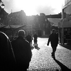 Liege (Peter Gutierrez) Tags: street old city houses people urban bw white black streets film public shop contrast square town photo europe european belgium belgique belgie pavement centre belgi center cobblestones sidewalk peter shops gutierrez format belgian cobbles liege narrow centrum luik contrasty lige wallon wallonie wallonia liegois wallone petergutierrez ligois liegoise ligoise liegoises ligoises